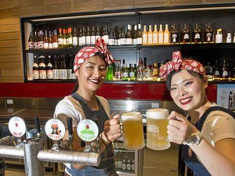 FUN FOOD: Working at Harajuku Gyoza is Sayo Kawahira (left) and Miyuki Mikami ready to serve beer.