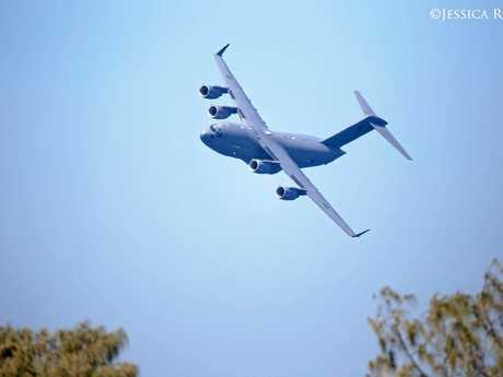 """'That moment when a C-17 Globemaster does a seriously low fly-over right in front of your house,"""" Jess Royal posted."""