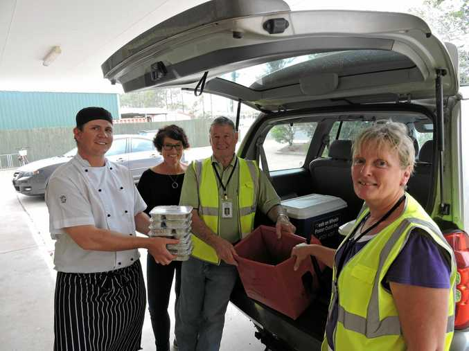 Meals on Wheels Maryborough is in desperate need of volunteer drivers like Dawn and Ken Hoare who also work in the kitchen with chef David Meier (left) and MOW co-ordinator Carly Partridge (2nd from left).