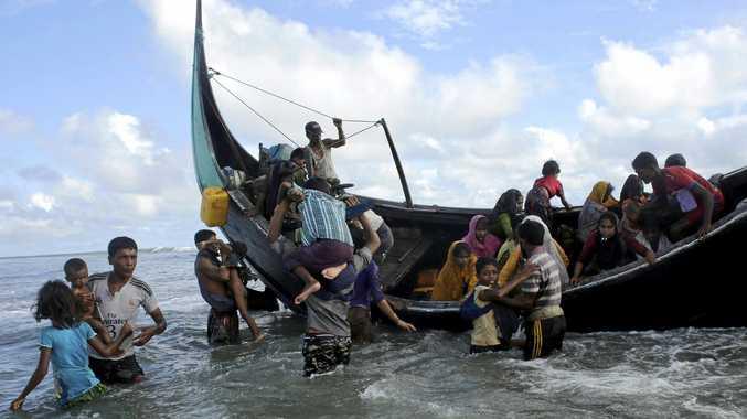 Rohingya refugees disembark from a boat at the shore of the Naf river, in Teknaf, Bangladesh.