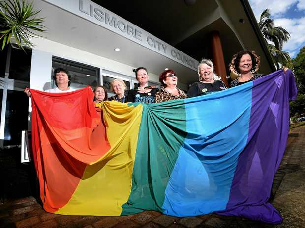 COUNCILLORS Darlene Cook and Elly Bird were on hand with supporters to raise a rainbow flag outside council chambers.