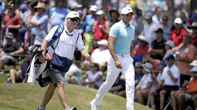 Jason Day has split with long-term caddie Colin Swatton (left).