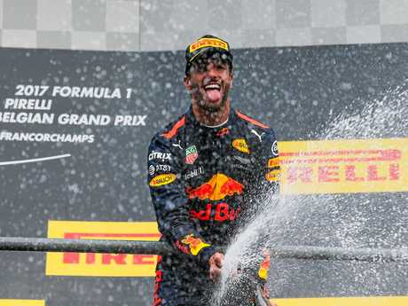 Daniel Ricciardo celebrates his third-place finish at the Belgium Grand Prix.