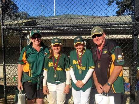 Met West U12 coach Janelle Hicks and manager Bevan Baker with Qld representatives Amelia Griffin (left) and Brooke Needham.