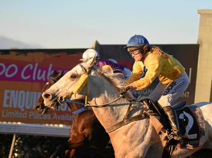 TOP RIDE: Clouds romps home to beat Unbowed in the feature race at the Gympie Turf Club.