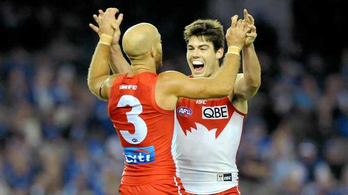 Jarrad McVeigh of the Swans (left) is congratulated by teammate George Hewett after a goal.