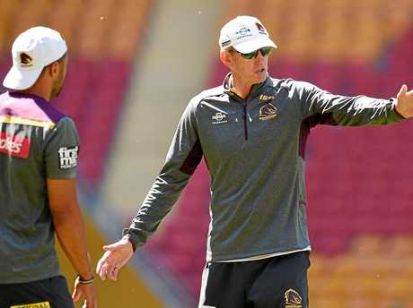 Broncos coach Wayne Bennett gives instructions during a training session.