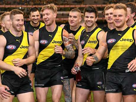 Tigers players (from left) Kane Lambert, Toby Nankervis, Nathan Broad, Dustin Martin, Trent Cotchin, David Astbury and Brandon Ellis celebrate after winning the second qualifying final against the Cats.