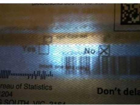 Shining a torch over a sealed envelope can reveal details of the ballot inside. Source: Facebook