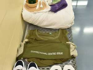 Prison-issue clothing and utensils