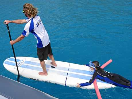A tired snorkeller getting a helping hand from Zig Zag staff.