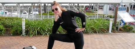 Molly Brown in her wetsuit at Abell Point Marina.