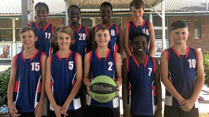 Coffs Harbour Public School's giant-killing Year 5/6 basketball team.