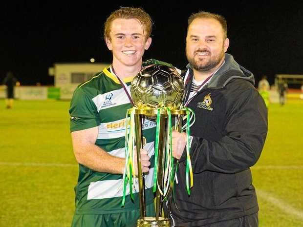 Western Pride captain Jesse Rigby with football operations manager Dan Burnell after the club's NPL Queensland grand final success.