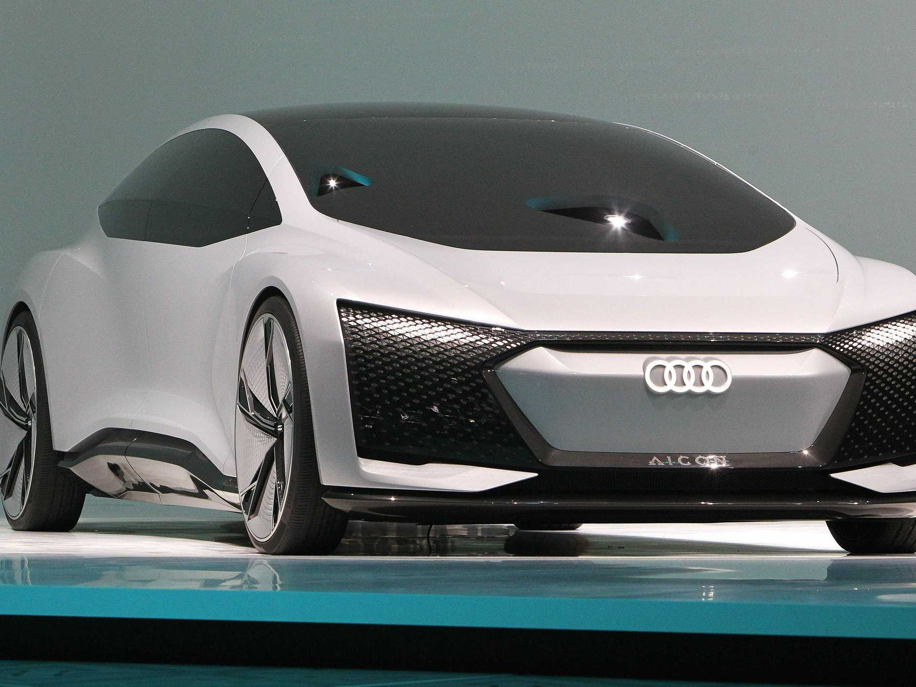 An Audi Aicon Concept car is presented at the Frankfurt Motor Show IAA in Frankfurt am Main, western Germany, on September 12, 2017.   According to organisers, around 1,000 exhibitors from 39 countries will showcase their products and services. This year's fair running from September 14 to 24, 2017 will focus on digitization, urban mobility and electric mobility. / AFP PHOTO / Daniel ROLAND