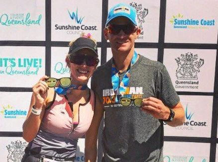 Commentator Riana Crehan and Will Davison celebrate their finish at Ironman 70.3 Sunshine Coast.