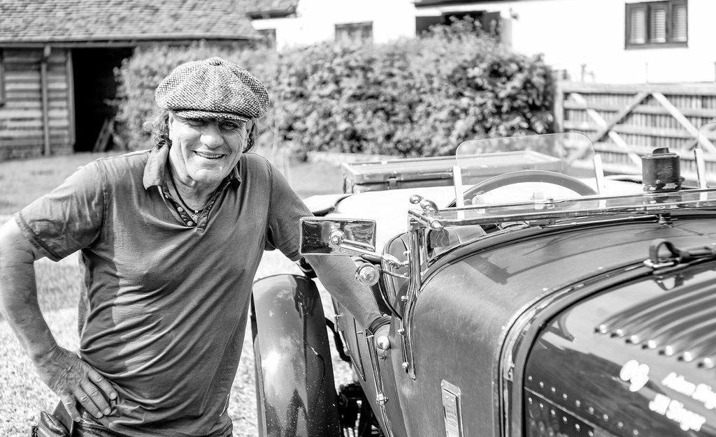 Brian Johnson leaning against the 1927 6.5 Bentley 2010 Peking to Paris car YT56 , while filming Cars the Rock.