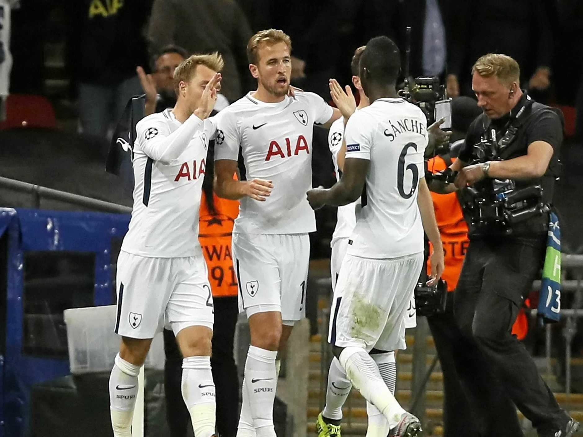 Tottenham's Harry Kane (centre) celebrates after scoring his side's third goal against Borussia Dortmund.