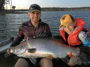 Big feat for little fisherman reeling in a 25kg barra