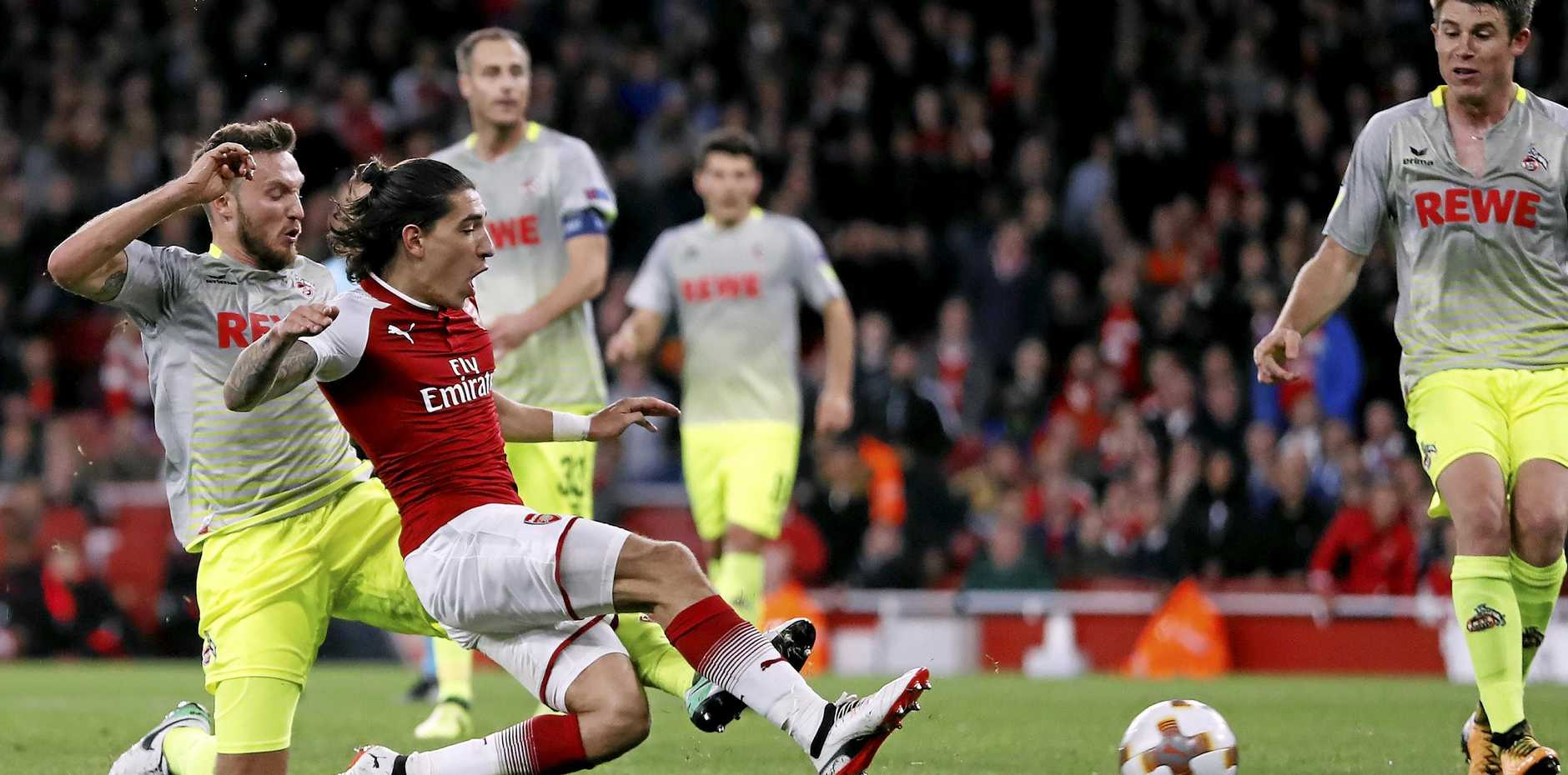 Arsenal's Hector Bellerin scores his side's third goal against FC Cologne at the Emirates Stadium.