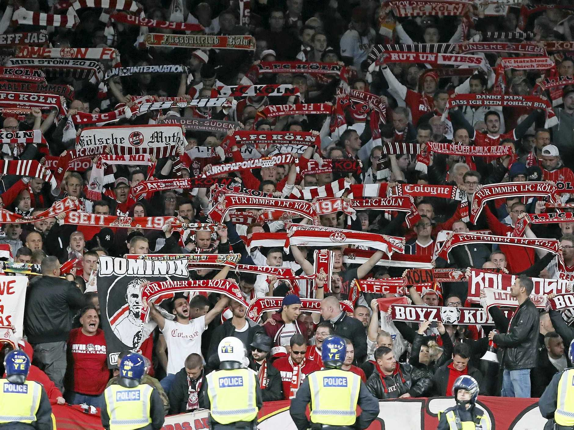 Cologne supporters cheer during the Europa League Group H soccer match against Arsenal.