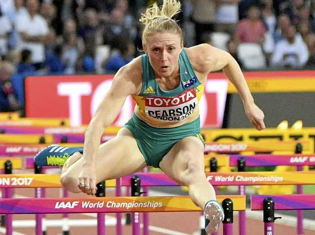 Australian Sally Pearson on her way to winning the women's 100m hurdles at the world championships in London.