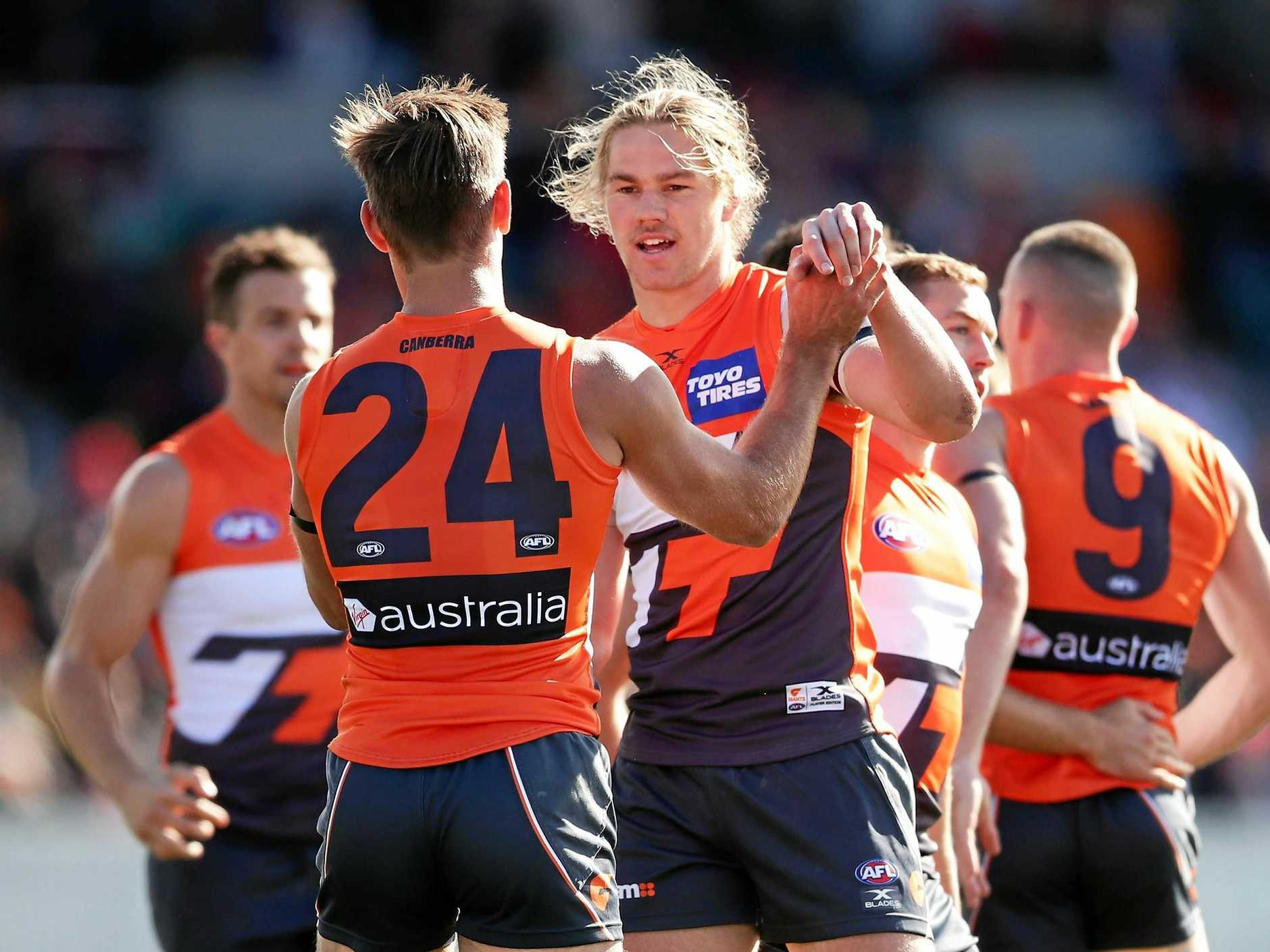 CANBERRA, AUSTRALIA - AUGUST 05:  Harrison Himmelberg of the Giants celebrates with team mates after kicking a goal during the round 20 AFL match between the Greater Western Sydney Giants and the Melbourne Demons at UNSW Canberra Oval on August 5, 2017 in Canberra, Australia.  (Photo by Matt King/Getty Images)