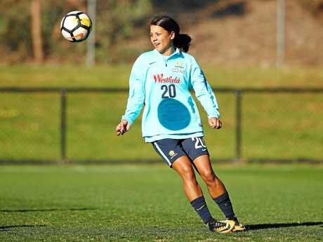 Sam Kerr of the Matildas controls the ball during a training session.