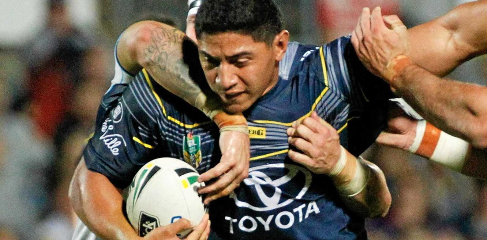 Cowboys forward Jason Taumalolo is tackled in a game against the Titans this year.