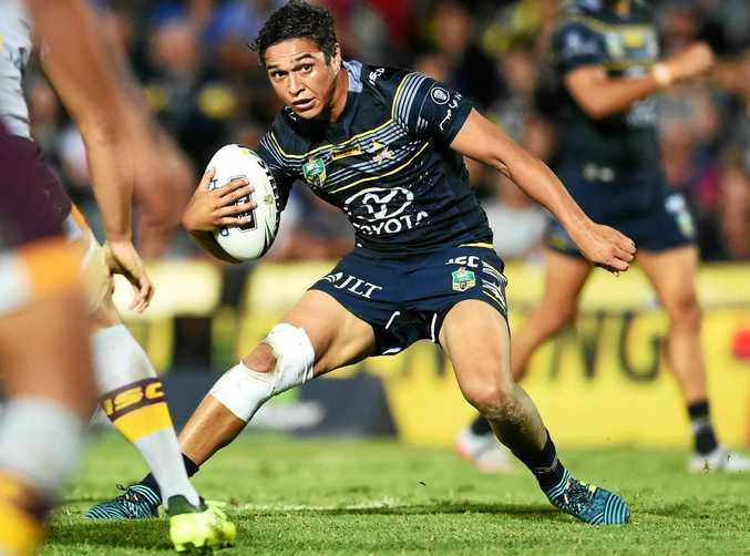 North Queensland's Te Maire Martin looks for a hole in the Brisbane defence.