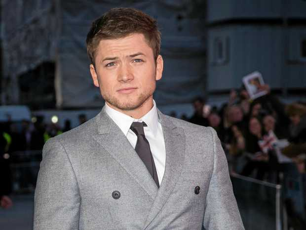 Actor Taron Egerton poses for photographers upon arrival at the premiere of the film 'Eddie the Eagle' in London, Thursday, March 17, 2016. (Photo by Vianney Le Caer/Invision/AP)
