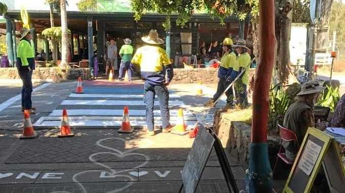 RAINBOW CONNECTION: Diana Roberts posted this photo on Nimbin Hook Ups of council workers painting over the rainbow crossing.