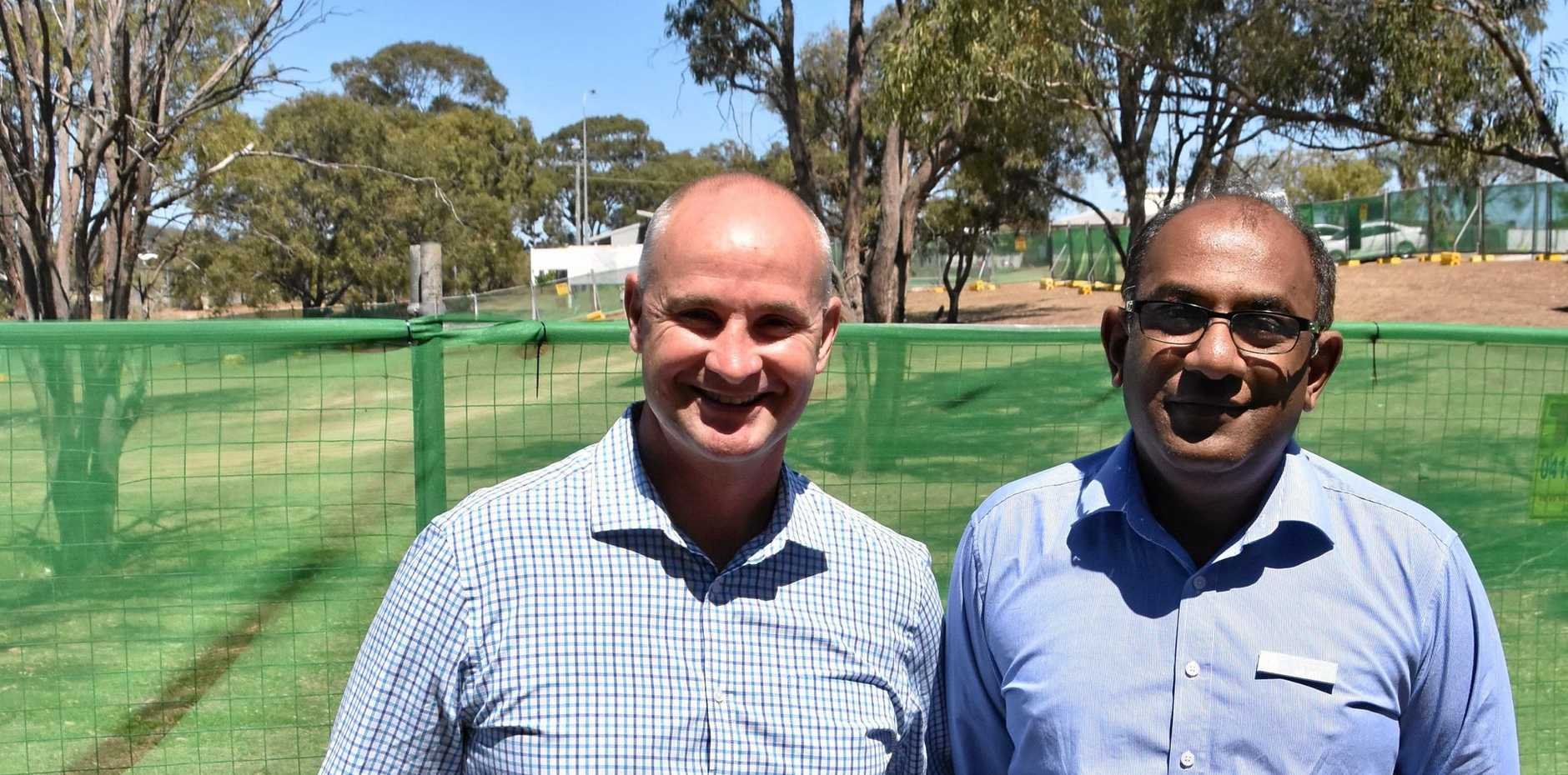 PROUD: Member for Gladstone Glenn Butcher and Central Queensland Hospital and Health Service acting chief executive Muku Ganesh.