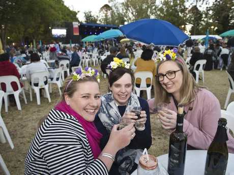 CHEERS: Enjoying Ergon Energy Food and Wine Festival are (from left) Laura McGrath, Natalie Lancuba and Hayley Tickle in Queens Park as part of Carnival of Flowers 2017.
