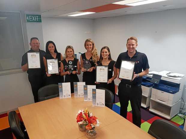 WINNERS: Team members of the Fuji Xerox Business Centre MNC celebrate their success.