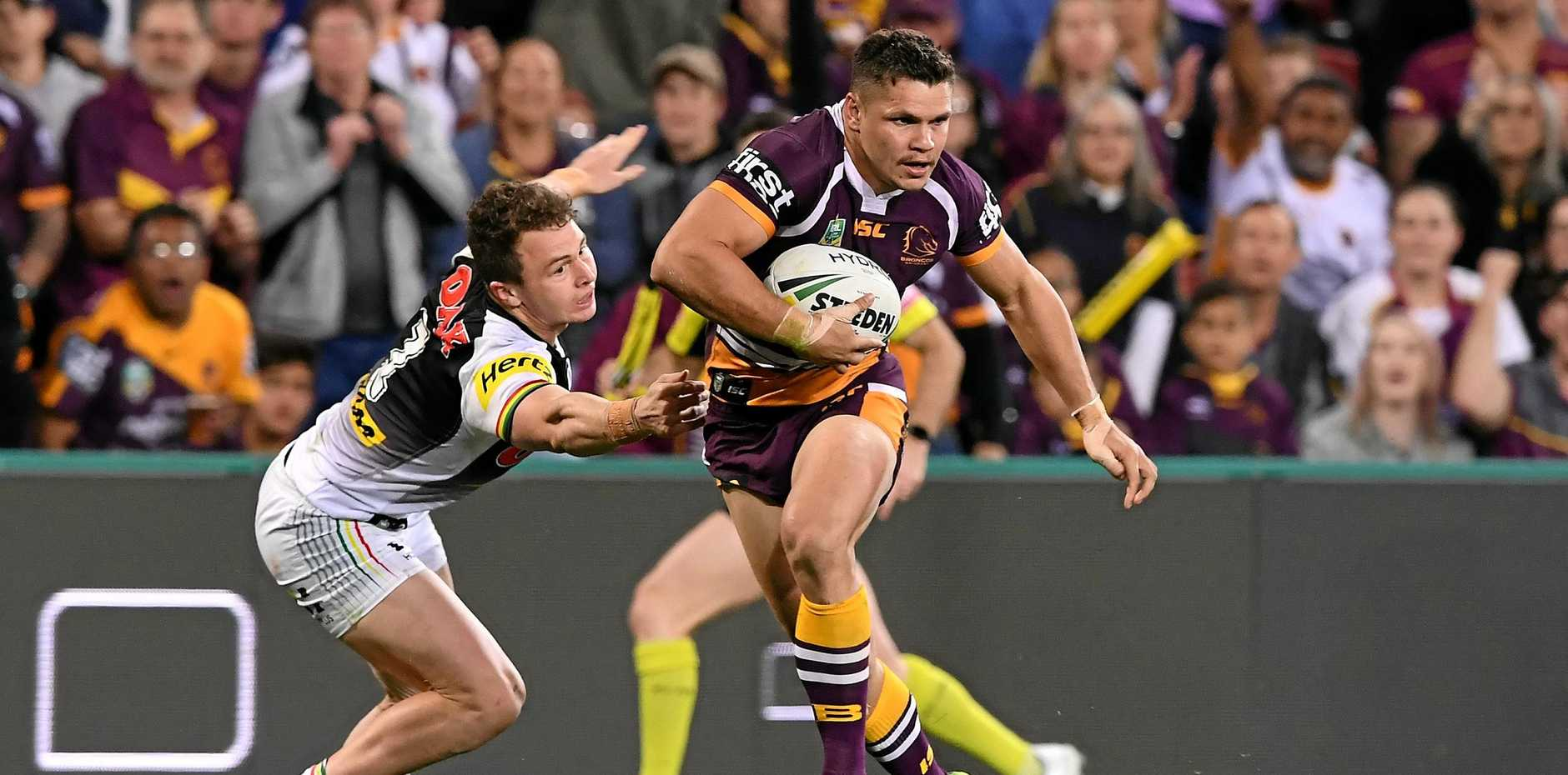 Broncos centre James Roberts beats Panthers fullback Tyrone Peachey before scoring a try.