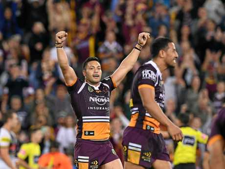 Broncos player Alex Glenn raises his arms in celebration at full-time of the semi-final against the Panthers.
