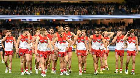 Swans players leave the field after their semi-final loss to the Cats.
