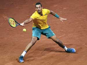 Kyrgios digs deep to keep Davis Cup tie in balance