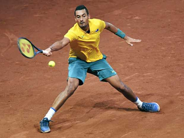 Australia's Nick Kyrgios reaches to return the ball to Belgium's Steve Darcis during their Davis Cup clash.