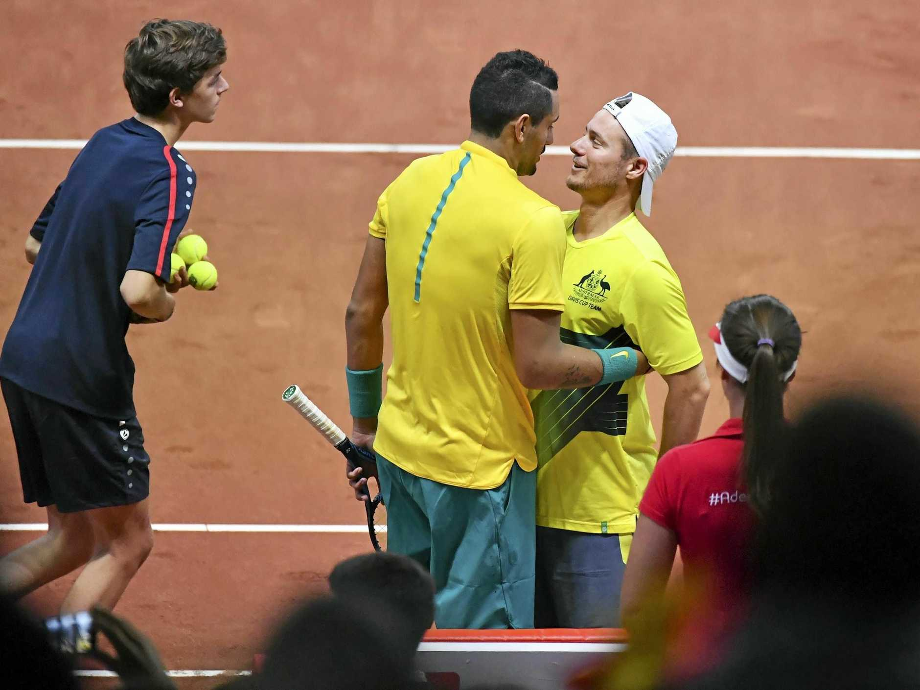 Australia's Nick Kyrgios (left) is congratulated by his team captain Lleyton Hewitt after beating Steve Darcis.