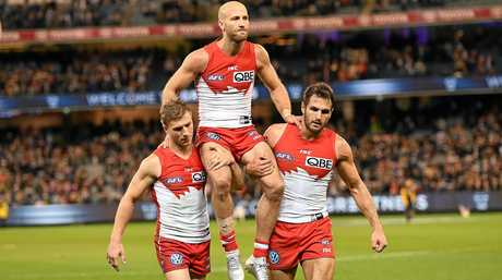 Jarrad McVeigh of the Swans is carried from the ground by Kieren Jack (left) and Josh Kennedy after playing his 300th game during the semi-final against Geelong.