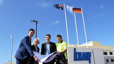 Minister for Main Roads, Road Safety and Ports Mark Bailey, Bundaberg MP Leanne Donaldson, Gladstone Port Corporation's Jason Pascoe and Knauf's Tim Foster at the new Knauf plasterboard factory.