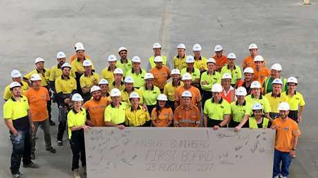 MISSION ACCOMPLISHED: Knauf Bundaberg team holding up the first plasterboard made at the factory.Photo Contributed