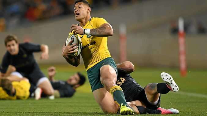 Israel Folau of the Wallabies is tackled by Jeronimo de la Fuente of Argentina.
