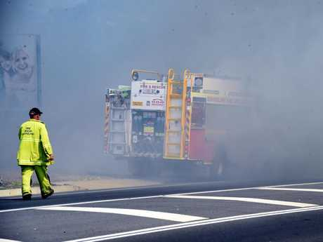 A paddock fire and the thick smoke it caused, disrupted traffic along Main St and Doolong Road, Urraween.