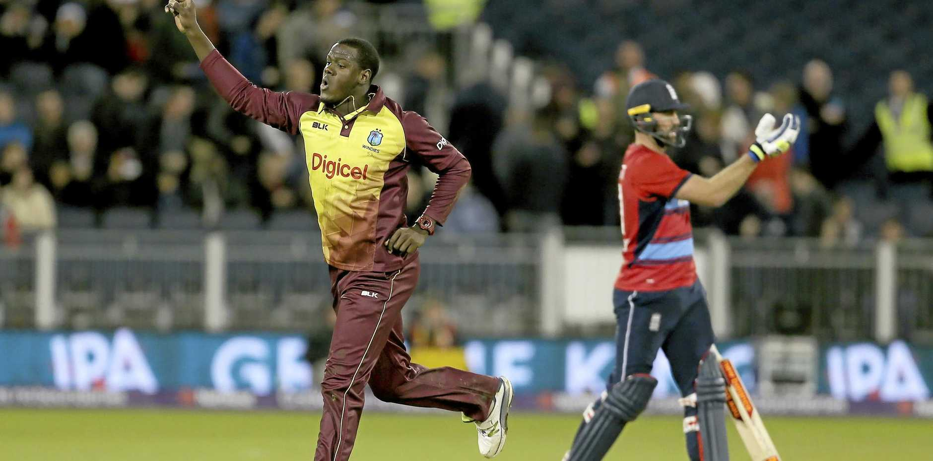 West Indies captain Carlos Brathwaite celebrates after taking the wicket of England's Liam Plunkett to win the T20 match in Durham.