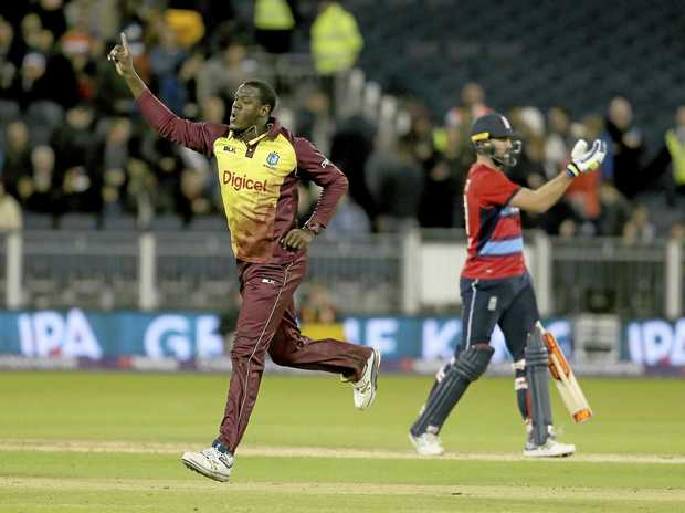 West Indies captain Carlos Brathwaite celebrates after taking the wicket of England's Liam Plunkett to win the T20 match in Durham