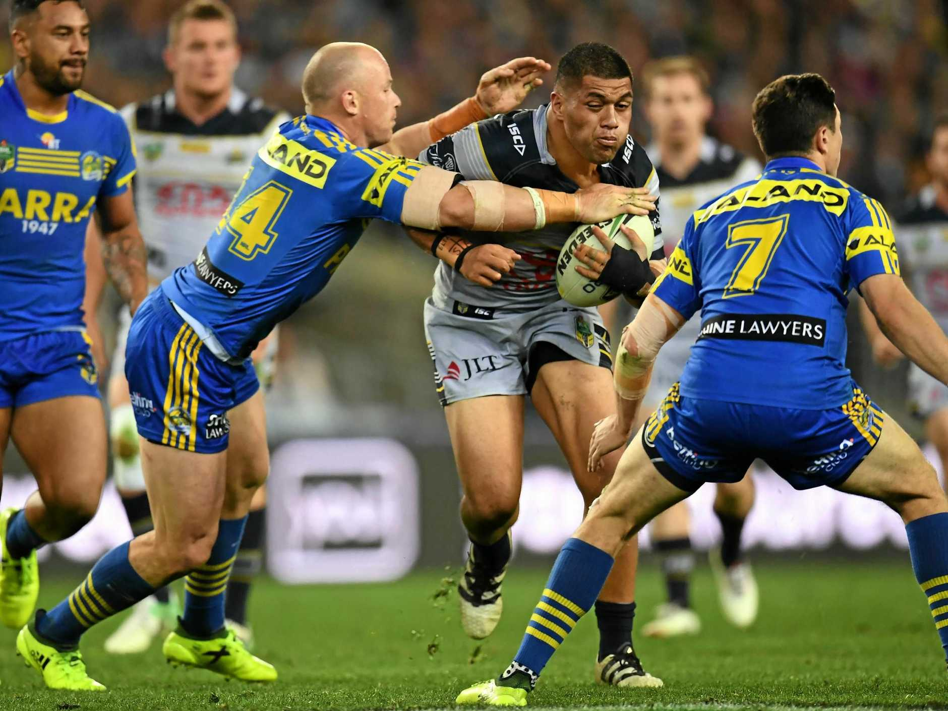 Beau Scott of the Eels tackles John Asiata of the Cowboys during their semi-final.