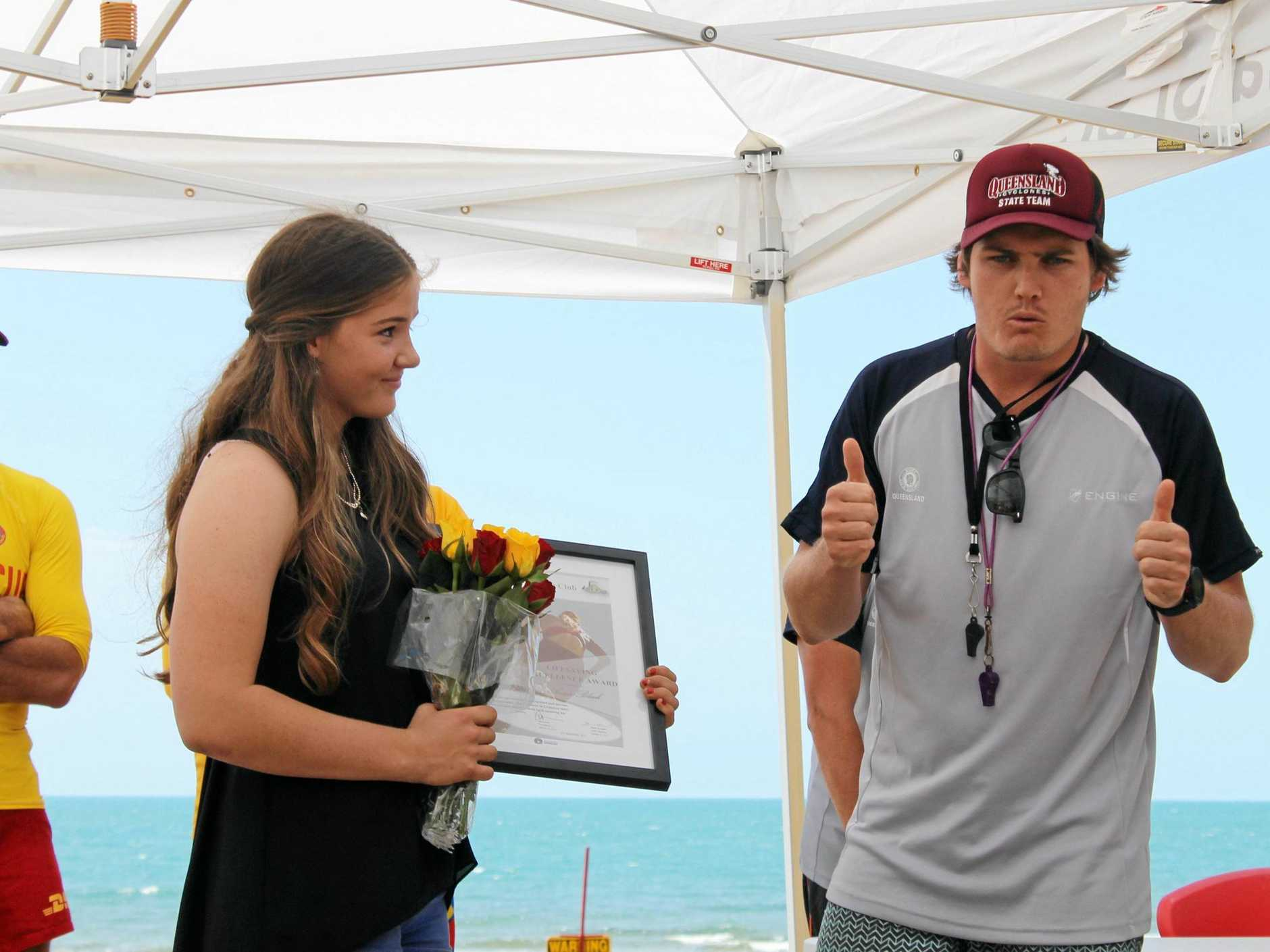 Grasstree Beach's Anna Black, 15, from Sarina Surf Lifesaving Club received a Lifesaving Excellence Award, presented by Matthew Palmer (SLSQ sport development coordinator) for saving a man who was in serious trouble after his kayak capsized.